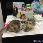 The Adventure Team Goes to BlogPaws - Sophie at CWA Table