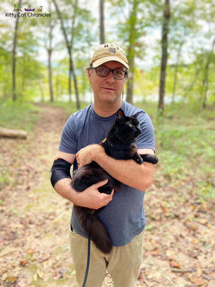 cat and man hiking at Sprewell Bluff Park